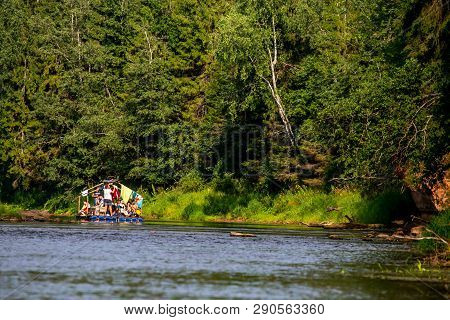 People Boating On River Gauja In Latvia, Peacefull Nature Scene. By Raft Through The River. Raft Tri
