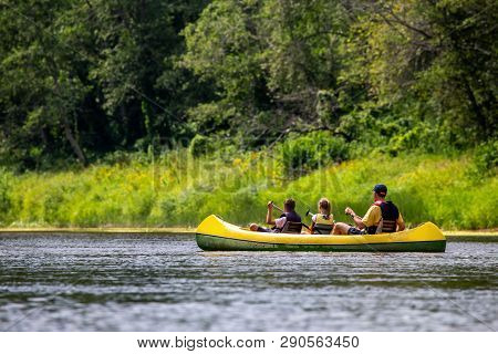 Family In Yellow Kayak Drives On The River. People Boating On River Gauja In Latvia, Peacefull Natur