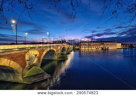 Pont Neuf (new Bridge) And Renovated Building Of Former Toulouse Hospital At Dusk, Toulouse, France