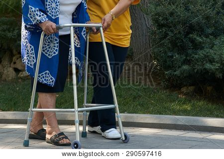 Elderly Physical Therapy By Caregiver In Hospital Backyard, Close-up