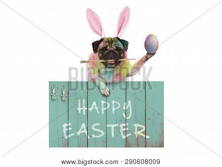 Colorful Easter Pug Dog Bunny Painting Easter Eggs With Paintbrush, Hanging On Vintage Wooden Sign W