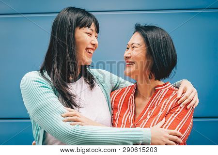 Asian Mother And Daughter Embracing Outdoor - Happy Chinese Family Enjoying Time Outside - Parenthoo