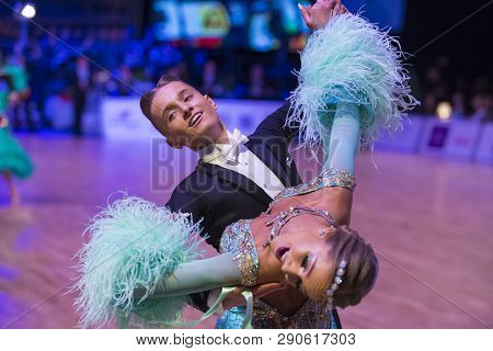 Riga, Latvia- December 16, 2018: Professional Adult Dance Couple Performs Youth Standard European Pr