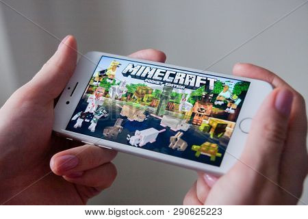 Los Angeles, California, Usa - 8 March 2019: Hands Holding A Smartphone With Minecraft Pocket Editio