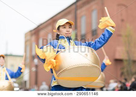Holland, Michigan, Usa - May 12, 2018 Chinese Drummers Promoting Falun Dafa Performing At The Muziek