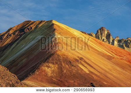 Bright Red And Yellow Colors At The Crater Of Famous Tunupa Volcano In Bolivia