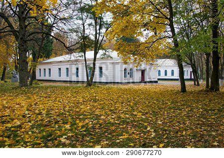Lyzohub Manor On The Background Of The Autumn Park  In Sedniv. Chernihiv Region. Ukraine. Horizontal
