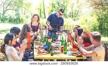 Happy Friends Having Fun Together At Barbecue Picnic Party - Young People Millenials At Pic Nic On O