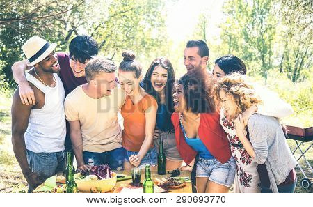 Happy friends having fun together at pic nic barbecue party - Young millenial people at picnic on open air festival - Youth friendship concept with guys and girls cheering at barbeque - Bright filter poster