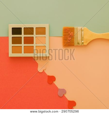 Palette Of Cosmetic Shadows On A Colorful Background With Hearts And An Exaggerated Construction Bru