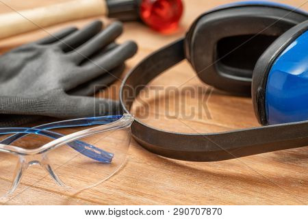 Personal Protective Equipment On A Wooden Background