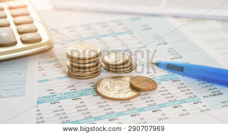 Some Coins On Documents With A Calculator