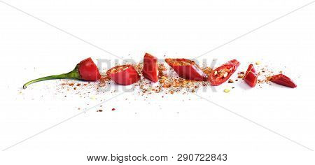 Red Chili Pepper, Cut Into Pieces And Isolated On White Background. Hot Spice, Red Chili Pepper And