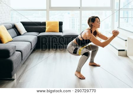 Adult Woman Training Legs Doing Side Squat At Home