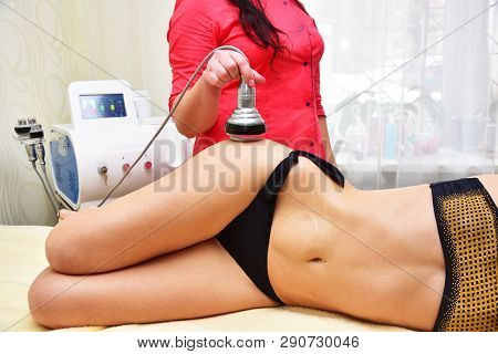 Rf skin tightening, belly. Hardware cosmetology. Body care. Non surgical body sculpting. Ultrasound cavitation body contouring treatment, anti-cellulite and anti-fat therapy in beauty salon. poster