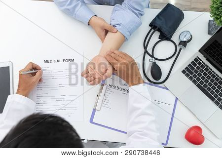 Healthcare And Medical Concept, Doctor Checking Patience's Pulse.