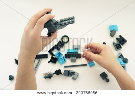 The Hands Of The Child Collector Constructor. The Child Collects The Designer. Child Playing With Co