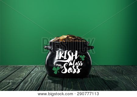 golden coins in black pot with irish lass full of sass lettering on green background poster