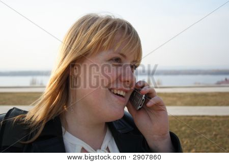 Pretty Girl Talking On Mobile Phone