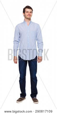 Front view of man in jeans. Standing young guy. Rear view people collection.  backside view of person.  Isolated over white background. The guy in the shirt is smiling.