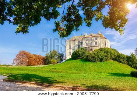 Picturesque postcard of Olesko castle. Location Lviv region, Ukraine, Europe. Adventure vacation. Attractive summer scene. Scenic image of popular tourist attraction. Discover the beauty of earth.