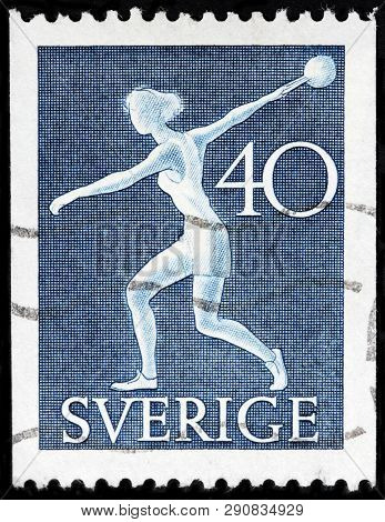 Luga, Russia - February 17, 2019: A Stamp Printed By Sweden Shows Sportswoman From The National Athl