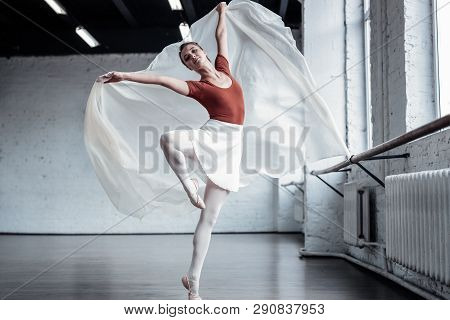 Nice Good Looking Young Woman Showing Pirouettes