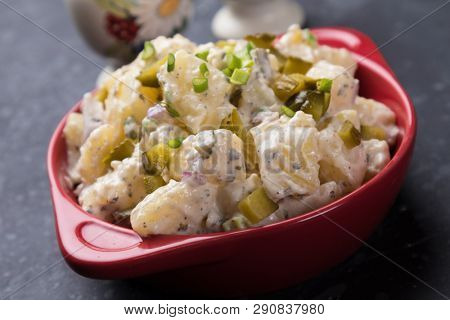 Potato salad with pickles, onion and mayonnaise dressing