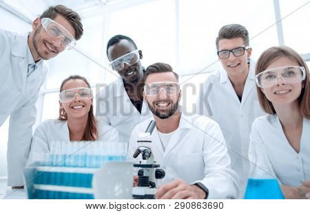 Group of young clinicians experimentation in research laboratory poster
