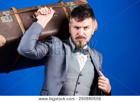 business trip with retro suitcase. stylish esthete with vintage bag. bearded man in formal suit. heavy bag. mature traveller. businessman in bow tie. Ready to new business trip. Stylish handsome man poster