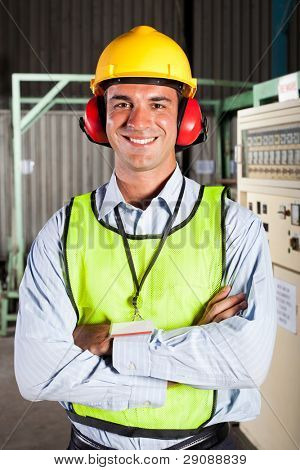 modern male factory worker with personal protective equipment