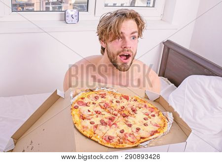 Man Bearded Handsome Guy Eating Cheesy Food For Breakfast In Bed. Food Delivery Service. Man Likes P