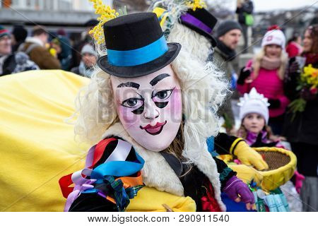 Basel, Switzerland - March 11, 2019: Participant At The Parade Of The Carnival Of Basel. The Carniva