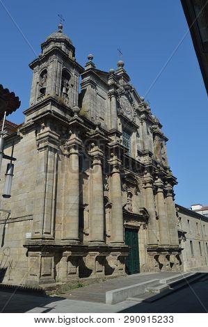 Main Facade Of The San Bartolome Parish On Sarmiento Street In Pontevedra. Nature, Architecture, His