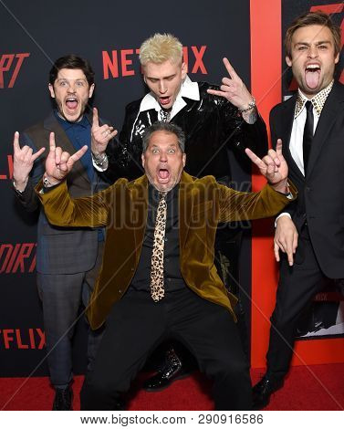 LOS ANGELES - MAR 18:  Jeff Tremaine, Iwan Rheon, Machine Gun Kelly and Douglas Booth arrives for the Netflix 'The Dirt' Premiere on March 18, 2019 in Hollywood, CA