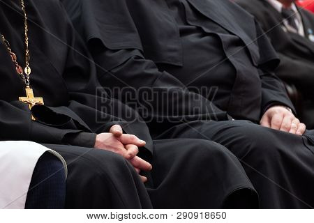 Meeting Clerics And Priests. Representatives Of The Orthodox Clergy In Black Robes Sit In The Confer
