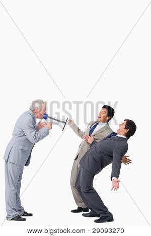 Mature salesman with megaphone yelling at his employees against a white background