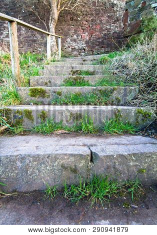 Grass Grows In The Cracks Of Old Stone Stairs On This Staircase In Shrewsbury, Shropshire, England.