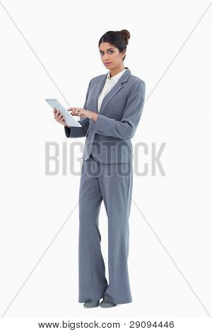 Saleswoman using tablet against a white background