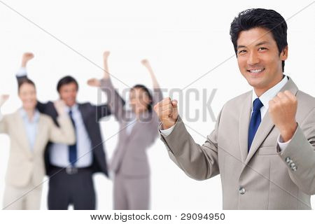 Successful businessman getting celebrated by colleagues against a white background