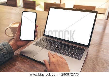 Mockup Image Of A Woman Touching On Laptop Touchpad With Blank White Desktop Screen While Using Mobi