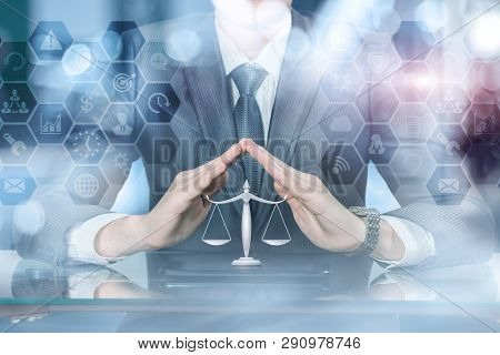 A Businessman Holding His Hands In Protective Position Under Scale Of Justice With Combs Network Str