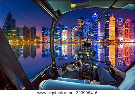 Helicopter Cockpit Interior Flying Over Doha Bay Harbour With Scenic Skyline Reflecting At Blue Hour