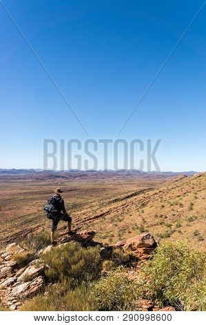 Man Enjoying View After A Hike To The Top Of Mount Sonder Just Outside Alice Springs, West Macdonnel
