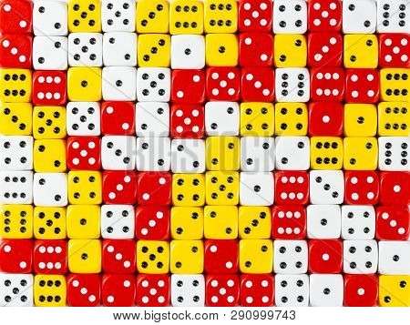 Pattern Background Of Random Ordered White, Red And Yellow Dices