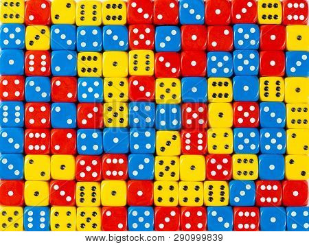 Pattern Background Of Random Ordered Red, Blue And Yellow Dices