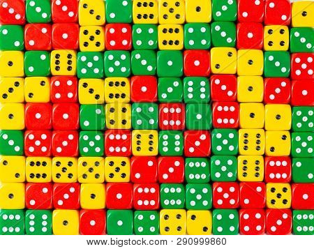 Pattern Background Of Random Ordered Red, Green And Yellow Dices