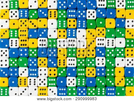 Pattern Background Of Random Ordered White, Yellow, Green And Blue Dices
