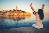 Woman traveler travels in a beautiful romantic old town of Rovinj in Croatia. Coastal city of Rovinj situated in Istria Peninsula east of Croatia Europe, it is famous travel destination of Croatia. t-shirt