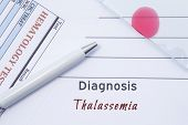 Diagnosis Thalassemia. Written by doctor hematological diagnosis Thalassemia in medical report, which are result of blood test and glass slide with blood smear for lab research poster